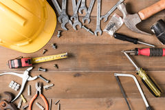 Set of tools supplies on wood background Stock Photos