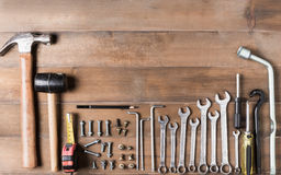 Set tools supplies on wood background. Royalty Free Stock Image