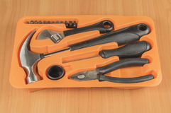 Set of tools in tool box on a wooden background.  stock photos