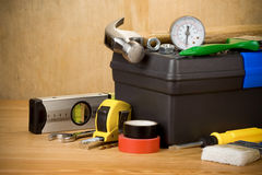 Set of tools and toolbox. On wood texture Stock Photo