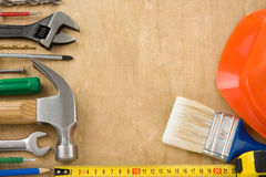 Set of tools on wood background Royalty Free Stock Images