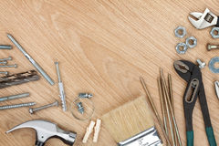 Set of tools on wood background Royalty Free Stock Image