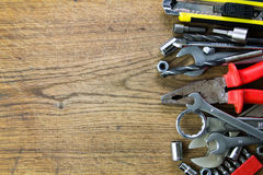 Set of tools on wood board background Royalty Free Stock Photos