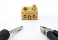Set of tools and wood house toy Royalty Free Stock Photos
