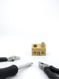 Set of tools and wood house toy on white background Stock Photography