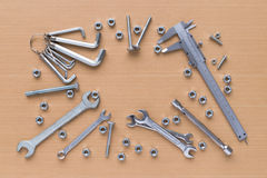 Set of tools on wooden background stock image