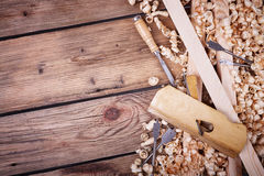 Set of tools for woodworking. Wooden planer, table from old wood, natural building materials, woodwork and antique hand tools, carrying out carpentry, tool kit Stock Photo