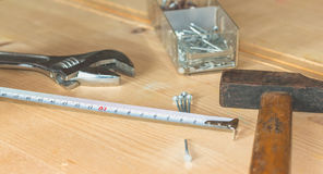 Set of tools on a workbench with nails Royalty Free Stock Photos