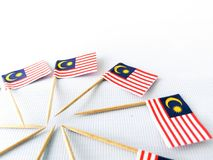 Set of toothpick with a small paper flag of Malaysia. Lined up and decorated on isolated white background. Bendera Malaysia, Flag Stock Photo