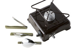 Set for the tourist. A spoon, a fork, a knife and portable gas stove on a white background Stock Images