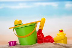 Set of toys in the sand Stock Image