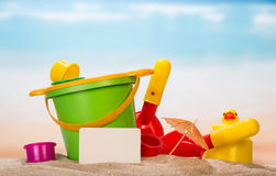 Set of toys in the sand Stock Images