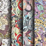Set of tracery colorful seamless patterns. Curved doodling backgrounds for textile or printing with mehndi and ethnic motives Stock Image