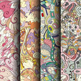 Set of tracery colorful seamless patterns. Curved doodling backgrounds for textile or printing with mehndi and ethnic motives. Vector Royalty Free Stock Photography