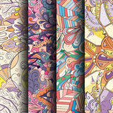 Set of tracery colorful seamless patterns. Curved doodling backgrounds for textile or printing with mehndi and ethnic motives. Vector Royalty Free Stock Photos