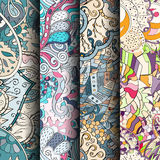 Set of tracery colorful seamless patterns. Curved doodling backgrounds for textile or printing with mehndi and ethnic motives Royalty Free Stock Image