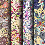 Set of tracery colorful seamless patterns. Curved doodling backgrounds for textile or printing with mehndi and ethnic motives. Vector Stock Images