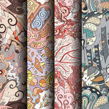 Set of tracery colorful seamless patterns. Curved doodling backgrounds for textile or printing with mehndi and ethnic motives. Vector Stock Image