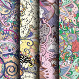 Set of tracery colorful seamless patterns. Curved doodling backgrounds for textile or printing with mehndi and ethnic motives. Vector Royalty Free Stock Image