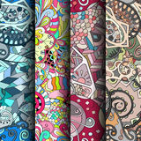 Set of tracery colorful seamless patterns. Curved doodling backgrounds for textile or printing with mehndi and ethnic motives. Vector Stock Photography