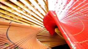 Set of traditional hand fans decorated with flowers and made in wood stock video footage