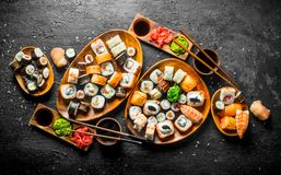 Set of traditional Japanese food sushi with soy sauce and ginger. On black rustic background stock photos