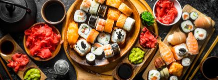 Set traditional Japanese sushi rolls on cutting boards stock images