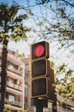 Set of traffic lights in Europe - red - seen against a backdrop of buildings and blue sky. royalty free stock images
