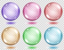 Transparent colored spheres with shadows. Set of translucent colored spheres with shadows on transparent background. Transparency only in vector format Royalty Free Stock Images