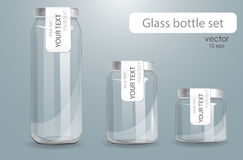 Set of transparent glass bottles. Stock Image