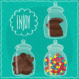 Set of transparent glass jars with sweets Royalty Free Stock Photos