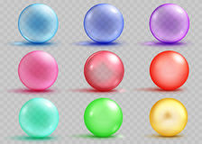 Set of transparent and opaque colored spheres with shadows. And glares on transparent background. Transparency only in vector file Royalty Free Stock Images