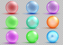 Set of transparent and opaque colored spheres with shadows. And glares on transparent background. Transparency only in vector file Royalty Free Stock Photo