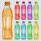 Set of transparent plastic bottles with multicolored juices Royalty Free Stock Image