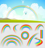 Set of transparent realistic rainbows. Summer landscape with clouds and rainbow Royalty Free Stock Image