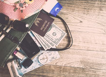 Set of travel accessory on wooden background Royalty Free Stock Photo