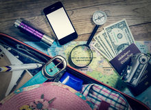 Set of travel accessory on wooden background Royalty Free Stock Images