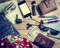 Set of travel accessory on wooden table Royalty Free Stock Photo