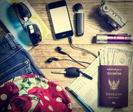 Set of travel accessory on wooden table Royalty Free Stock Image