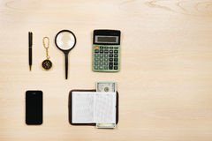 Set of travel items. Top aerial view. Set of travel items including magnifying glass, compass, calculator, pen, notebook, mobile phone and money. Planning of Royalty Free Stock Photos