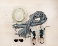 Set of travel items. Top aerial view. Set of travel items including  shoes, scarf,  sunglasses and straw hat. Planning of  overhead of essentials for vacation Royalty Free Stock Image