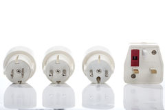 Set of travel plugs for UK, Europe and America. Four different plugs as part of a travel changing system, supporting power outlets for Northern Europe, Southern Royalty Free Stock Photo