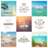Set of travel and vacation type emblems and symbols. On a defocused backgrounds Stock Image