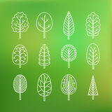 Set of trees on blurred background. Royalty Free Stock Image