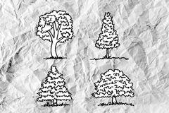 Set of trees with leaves on crumpled paper Stock Image