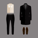 Set of trendy men's clothes with pants, coat, shirt and loafers Royalty Free Stock Photography