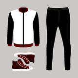 Set of trendy men's clothes with pants, windbreaker and sneakers Royalty Free Stock Photo