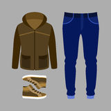 Set of trendy men's clothes with parka, jeans and sneakers. Stock Photo