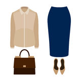 Set of  trendy women's clothes with blue skirt, blouse and acces Royalty Free Stock Photography