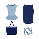 Set of  trendy women's clothes with blue skirt, top and accessor Royalty Free Stock Images